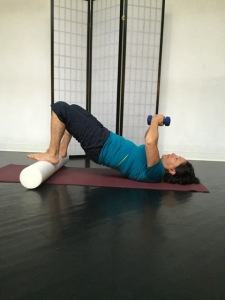 lisa in bridge with weights and foam roller